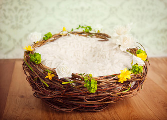 Nest with spring flowers