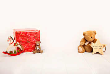 Christmas present, and christmas toys, against a white background