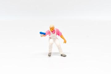 Miniature people Paint worker construction concept