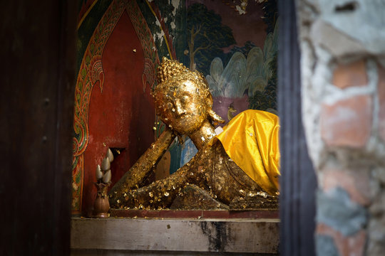 Buddha in the ancient church at Chachoengsao province,Thailand. The old Buddha statue in which there is a gold plate in the church.