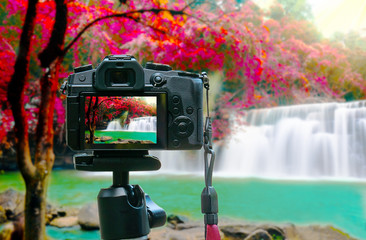 Photo of beawtiful waterfall on camera display while shooting