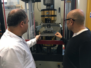 Lancaster University researchers Hasan Hasan and Professor Mohamed Saafi watch carrot-based concrete being stress-tested in their laboratory in Lancaster