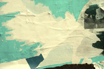 Old grunge ripped torn vintage collage posters creased crumpled paper surface placard texture background backdrop empty scraped blank space for text