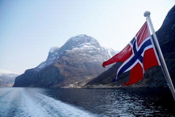 Norway Flag on sea and mountains background