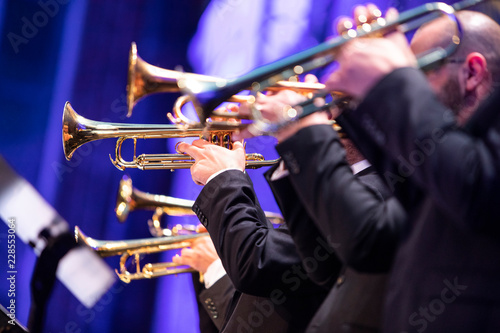 A big band trumpet section during a live performance