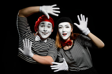 Smiling mimes in striped shirts