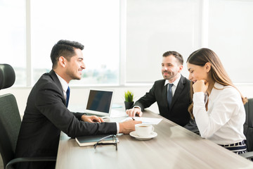 Colleagues Sharing Thoughts Over Plan In Office