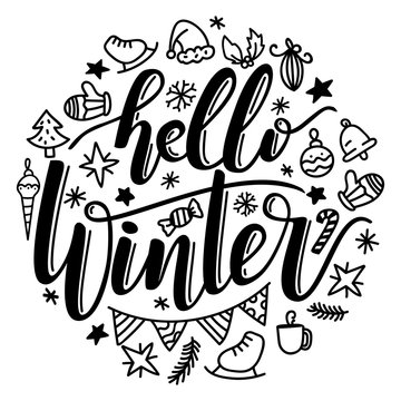 Hand written lettering hello winter with elements.