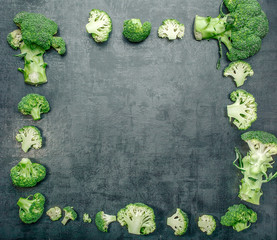 Fresh raw broccoli on a dark background.Top view. Free space.