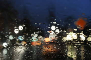 Raindrops on the glass in the evening.