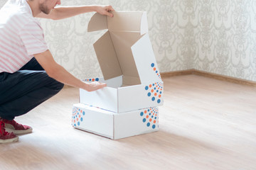 man carry cartoon boxes and move to the new home flat concept f