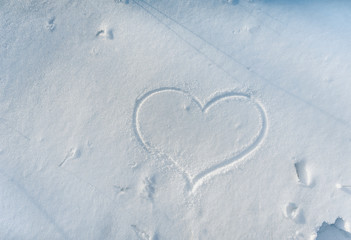 Heart drawn in the snow. Love winter. Walk in the winter forest.