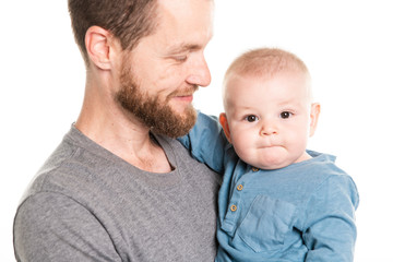 Father with cute baby on studio white background