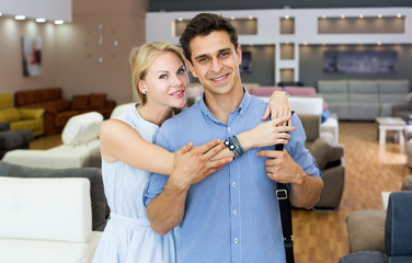 Man and woman are happyning of new sofa
