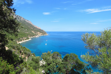 Beautiful panoramic view over the Mediterranean Sea with pleasure boats sailing along the blue bay and curved coastline