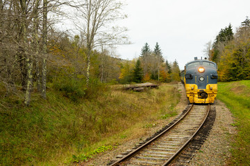 Diesel engine rounding a corner on a hilltop in the fall