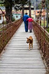 Old couple walking in a wooden bridge in Cuenca