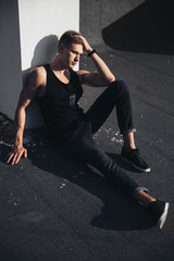 Male model, juicy guy on the roof, sporty man, athletic body