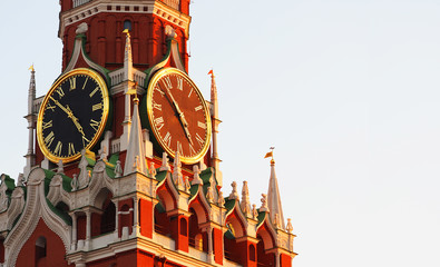 Kremlin Clock or chimes, historic clock on the Spasskaya Tower of the Moscow Kremlin, Russia. Panoramic view, sunset, sunlight