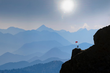 Successful climber, charming mountains and amazing landscapes