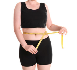 Overweight woman measuring waist before weight loss on white background