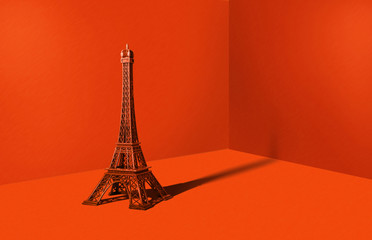 Eiffel tower in an orange room. Minimalistic concept, travel and sightseeing. A metal statue of the Eiffel Tower on a strong orange background. Fototapete