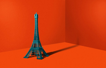 Figure of the Eiffel Tower in a heavy orange color. Travel concept, minimal style. An abstract theme, a modern approach to design.