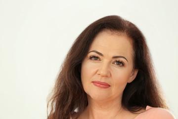 Portrait of beautiful older woman on light background