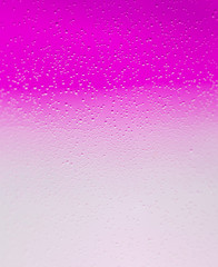 purple bubbles in water close-up abstract background