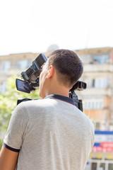 Cameraman working in the street