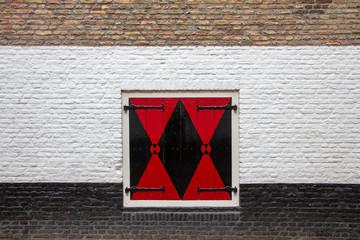 red warning sign on brick wall