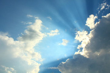 A beautiful blue sky with large clouds and sunbeams. Background. Landscape.