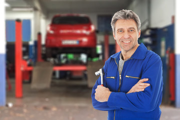 Portrait of automechanic holding a wrench