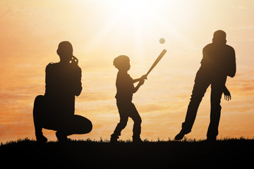 Silhouette Of Family Playing Baseball