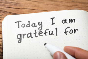 Person Writing Today I Am Grateful For Text On Notebook