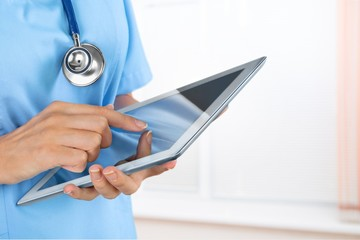 Doctor using digital tablet.