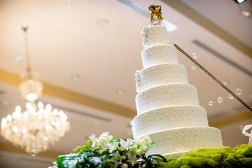Vintage Wedding Cake.Wedding cake decorate with Cupid doll.Image of a beautiful wedding cake at wedding reception.