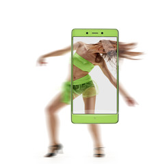 Beautiful graceful belly dancing woman on smartphone screen. conceptual image with a smartphone, demonstration of device capabilities