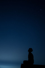 silhouette of man on blue background