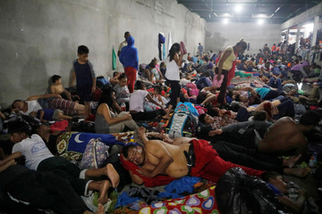 Honduran migrants, part of a caravan trying to reach the U.S., rest inside a shelter during a new leg of their travel in   Tecun Uman