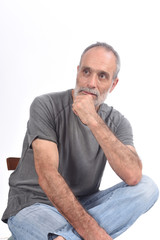 portrait of middle aged man sitting  on white