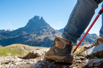 close up of hiker shoes , the Pic Ossau on background
