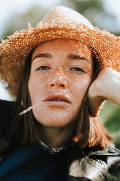 Portrait of a beautiful young woman with freckles