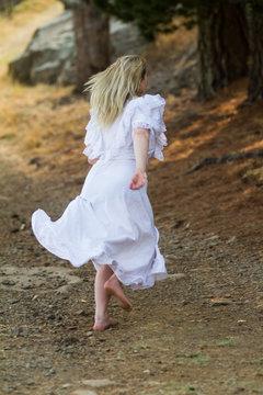 girl in white dress running away
