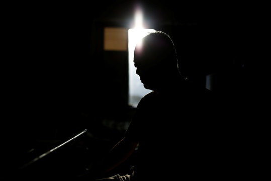 Sumitaka Horiguchi is silhouetted at his room of a nursing home where he lives during an interview with Reuters in Yokosuka