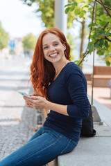 Friendly cheerful young redhead woman