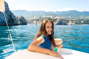 Woman resting on a catamaran in the sea