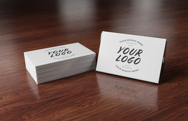 White business card stack on wooden desk 3D rendering