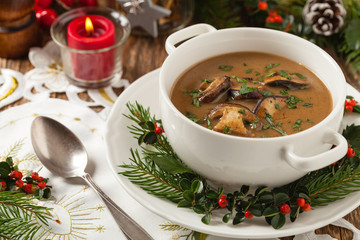 Traditional mushroom soup, made from porcini mushrooms. Christmas decoration.