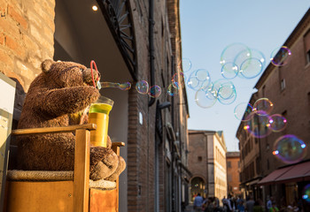 The teddy bear in Ferrara  blowing bubbles. Allegory of election policy promises